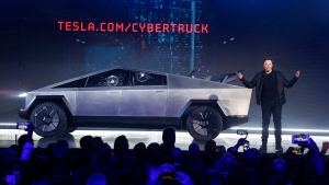 Tesla CEO Elon Musk introduces the Cybertruck at Tesla's design studio Thursday, Nov. 21, 2019, in Hawthorne, Calif. (AP Photo/Ringo H.W. Chiu)