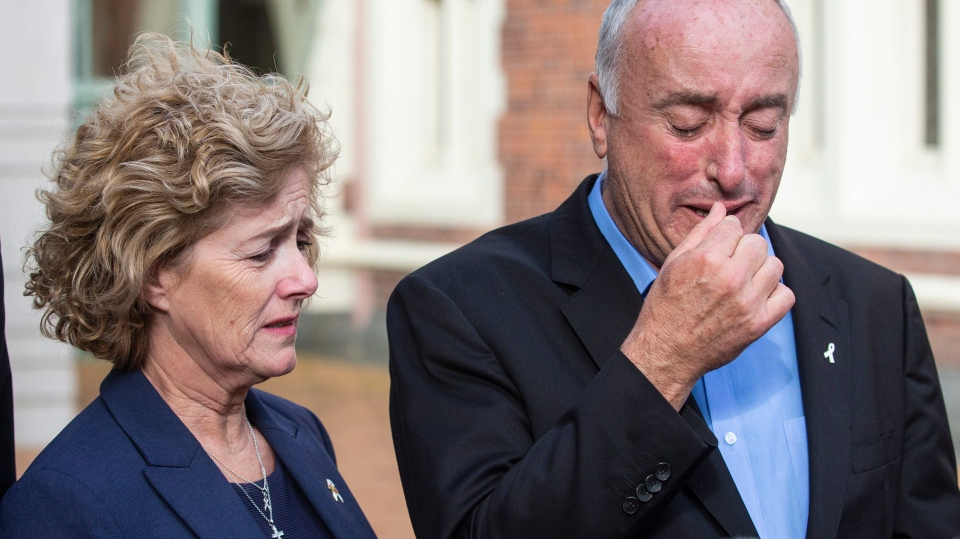 Parents of murdered British backpacker Grace Millane, Dave and Gillian react as they speak to the media outside the High Court, in Auckland, New Zealand, Friday, Nov. 22, 2019. (Jason Oxenham/New Zealand Herald via AP)