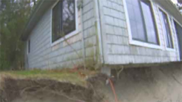 House at risk of falling into Michigan River