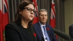 Manitoba's families minister Heather Stefanson speaks as Premier Brian Pallister listens in this file image.  THE CANADIAN PRESS/John Woods