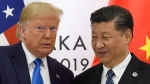 In this June 29, 2019, file photo, U.S. President Donald Trump poses for a photo with Chinese President Xi Jinping during a meeting on the sidelines of the G-20 summit in Osaka, western Japan. (AP Photo/Susan Walsh)