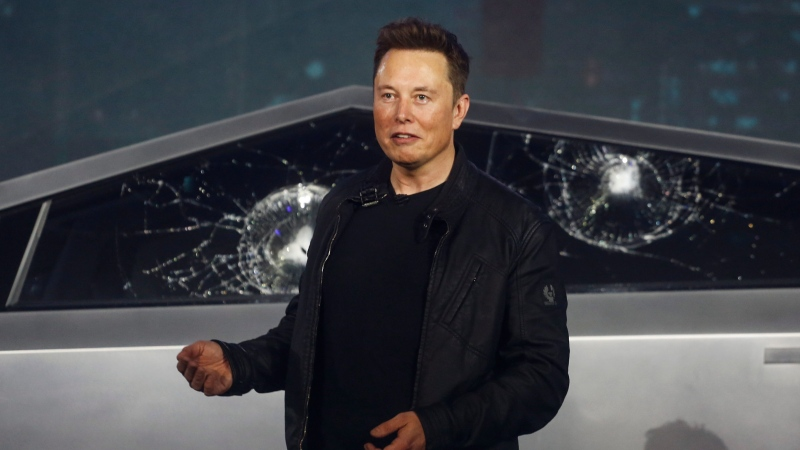 Tesla CEO Elon Musk introduces the Cybertruck at Tesla's design studio Thursday, Nov. 21, 2019, in Hawthorne, Calif. Musk is taking on the workhorse heavy pickup truck market with his latest electric vehicle. (AP Photo/Ringo H.W. Chiu)