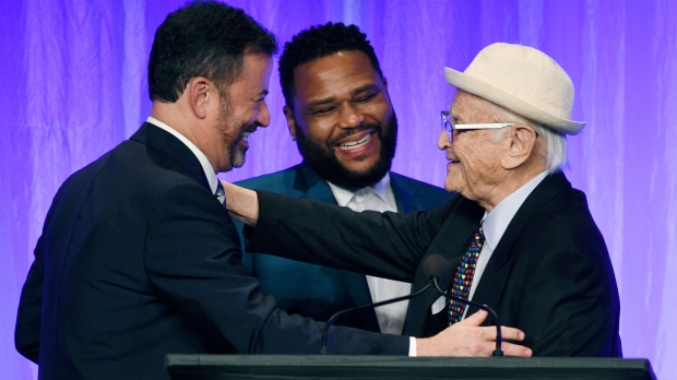 "Honoree Norman Lear, right, is congratulated by presenters Jimmy Kimmel, left, and Anthony Anderson onstage at ""The Paley Honors: A Special Tribute to Television's Comedy Legends"" at the Beverly Wilshire Hotel, Thursday, Nov. 21, 2019, in Beverly Hills, Calif. (Photo by Chris Pizzello/Invision/AP)"