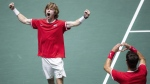 Russia's Karen Khachanov, right, and Andrey Rublev celebrate after winning the Davis Cup quarterfinal doubles match against Serbia's Novak Djokovic and Viktor Troicki in Madrid, Spain, on Nov. 22, 2019. (Bernat Armangue / AP)