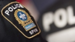 A Montreal Police badge is shown during a news conference in Montreal, Monday, October 7, 2019. THE CANADIAN PRESS/Graham Hughes