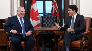 Prime Minister Justin Trudeau and the Premier of Ontario Doug Ford share a laugh after Ford spoke in French during a meeting in Ottawa on Friday, Nov. 22, 2019. THE CANADIAN PRESS/Adrian Wyld