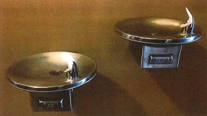 """The Senate building's drinking fountains had metal buttons embossed with the English word """"PUSH."""""""