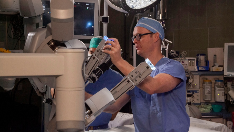 Urologist and cancer surgeon Dr. Ross Mason is shown with the Da Vinci surgical robot is this undated handout image.  (THE CANADIAN PRESS/HO-Nova Scotia Health Authority)