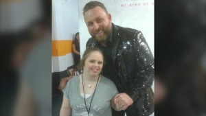 Country star Johnny Reid poses for a photo with superfan Vicki Gould before his concert at Centre 200 in Sydney, N.S., on Nov. 21, 2019. (Lori Gould)