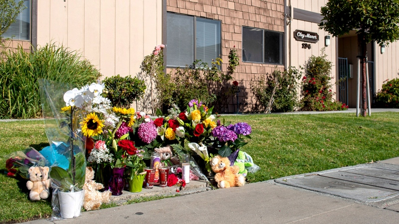 "A sidewalk memorial outside Mariana Jurado's apartment in Salinas, Calif., is seen Friday, Nov. 22, 2019. Police in central California say a pregnant woman was stabbed to death in a random attack outside her home. Police say 26-year-old Mariana Jurado was leaving for work Tuesday morning when 43-year-old Garrett Scheff stabbed her multiple times in a ""random act of violence."" Jurado was taken to a hospital, where she died. Police arrested Scheff shortly afterward on suspicion of first-degree murder. (David Rodriguez/The Californian via AP)"