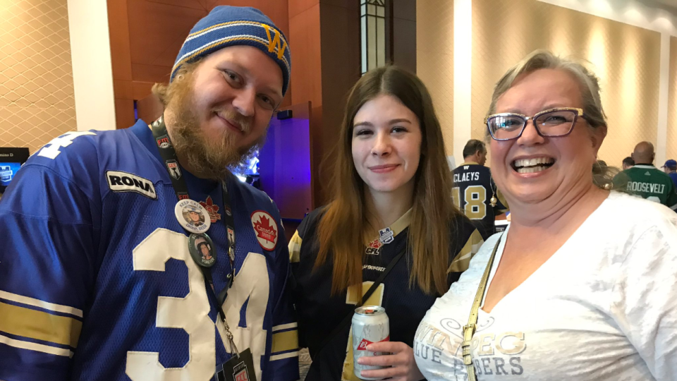 Bomber fans Svein (on the left, who's 22 and has been to 23 grey cups, figure that out), Shannon, and Sherry. (Source: Pat McKay/CTV News Winnipeg)