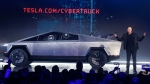 Tesla CEO Elon Musk introduces the Cybertruck at Tesla's design studio Thursday, Nov. 21, 2019, in Hawthorne, Calif. Musk is taking on the workhorse heavy pickup truck market with his latest electric vehicle. (AP / Ringo H.W. Chiu)