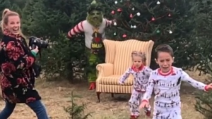 Joseph DeVito's wife Ashley set up the prank with her friend, the photographer, and an acquaintance who dressed up as the Grinch. He explained his children knew someone would be dressing up and popping up as the classic character, but not necessarily when. (ashleymariemua/Instagram)