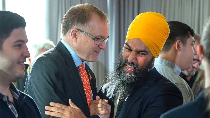 NDP Leader Jagmeet Singh, right, shares a light moment with Peter Julian, MP for New Westminster-Burnaby at a campaign event in Vancouver on Wednesday, Sept. 25, 2019. THE CANADIAN PRESS/Andrew Vaughan