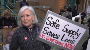 Advocates for drug policy reform gathered outside the Victoria Conference Centre in November to push the BC NDP to do more to address the province's overdose crisis. Among them was Jennifer Howard, pictured. (CTV News)