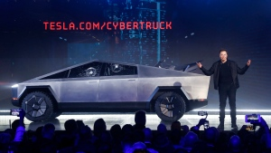 In this Thursday, Nov. 21, 2019, file photo, Tesla CEO Elon Musk introduces the Cybertruck at Tesla's design studio in Hawthorne, Calif. (AP Photo/Ringo H.W. Chiu, File)