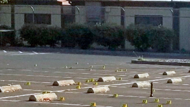 This Saturday, Nov. 23, 2019, photo released by the Union City Police Department shows crime scene evidence markers at the parking lot of the Searles Elementary School in Union City, Calif. (Union City Police Department via AP)