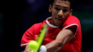 FILE - Canada's Felix Auger-Aliassime returns the ball to Spain's Roberto Bautista Agut during their tennis singles match of the Davis Cup final in Madrid, Spain, Sunday, Nov. 24, 2019. (AP Photo/Manu Fernandez)