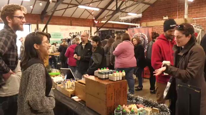 People crowding a vegan market in Kitchener