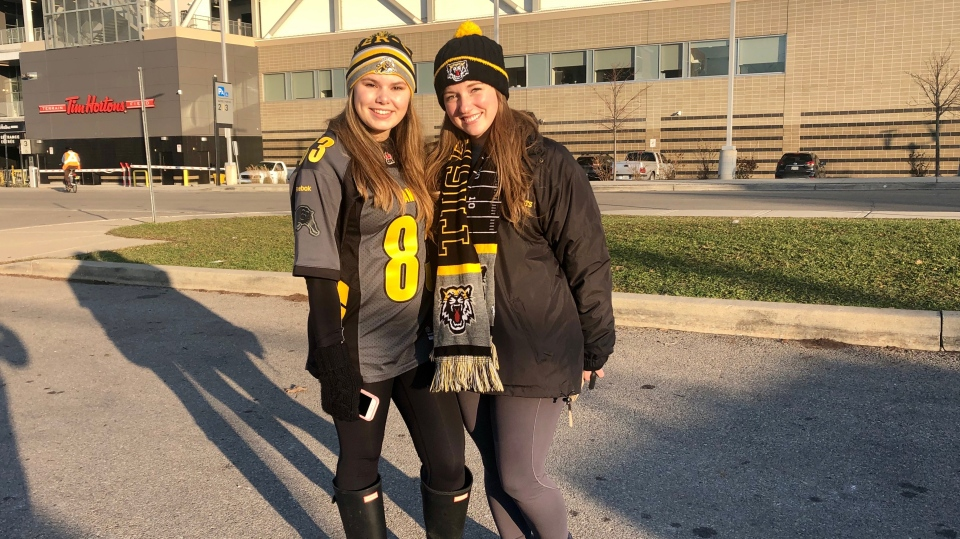 Two Ticat fans prepare to watch their team face off against the Blue Bombers in the Grey Cup on Sunday. (Natalie Johnson/CTV News Toronto)