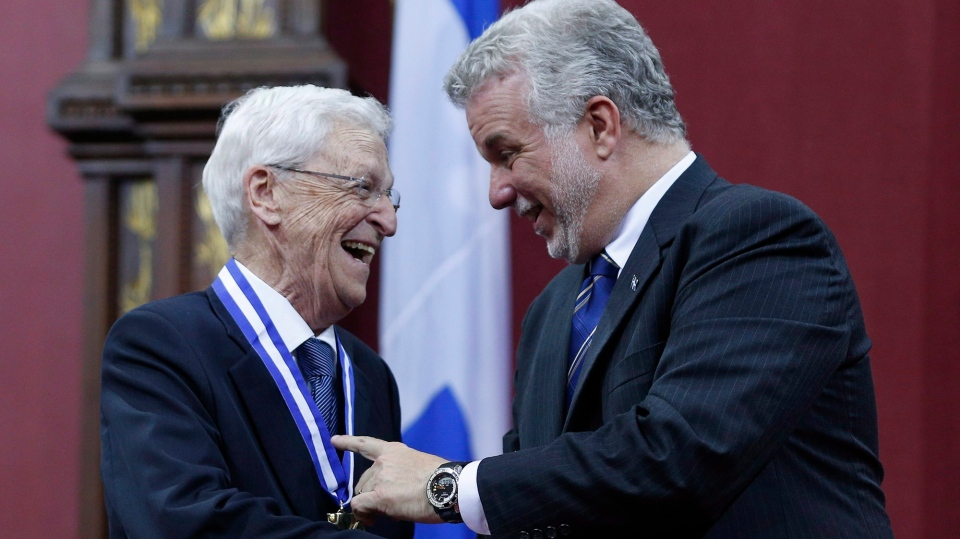 Claude Beland, left, former president of Mouvement Desjardins, shares a laugh with Quebec's Premier Philippe Couillard after receiving the rank of Grand Officer in the Ordre National du Quebec, at the national assembly in Quebec City, Wednesday, June 18, 2014. Beland died at 87, Nov. 24, 2019. THE CANADIAN PRESS/Mathieu Belanger