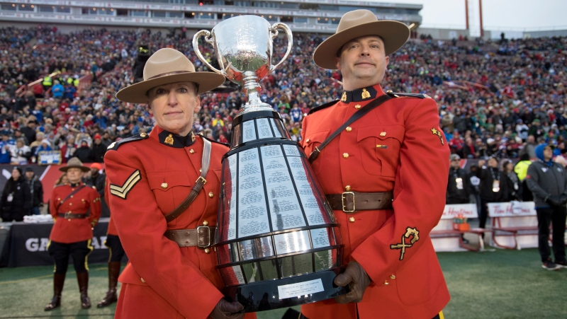 Members of the RCMP carry the Grey Cup during the 107th Grey Cup in Calgary, Alta., Sunday, November 24, 2019. THE CANADIAN PRESS/Frank Gunn