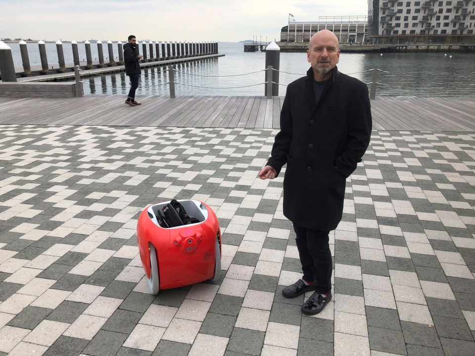 Piaggio Fast Forward co-founder Jeffrey Schnapp talks about his company's cargo-carrying robot called the Gita on Monday, Nov. 11, 2019, in Boston. (AP Photo/Matt O'Brien)