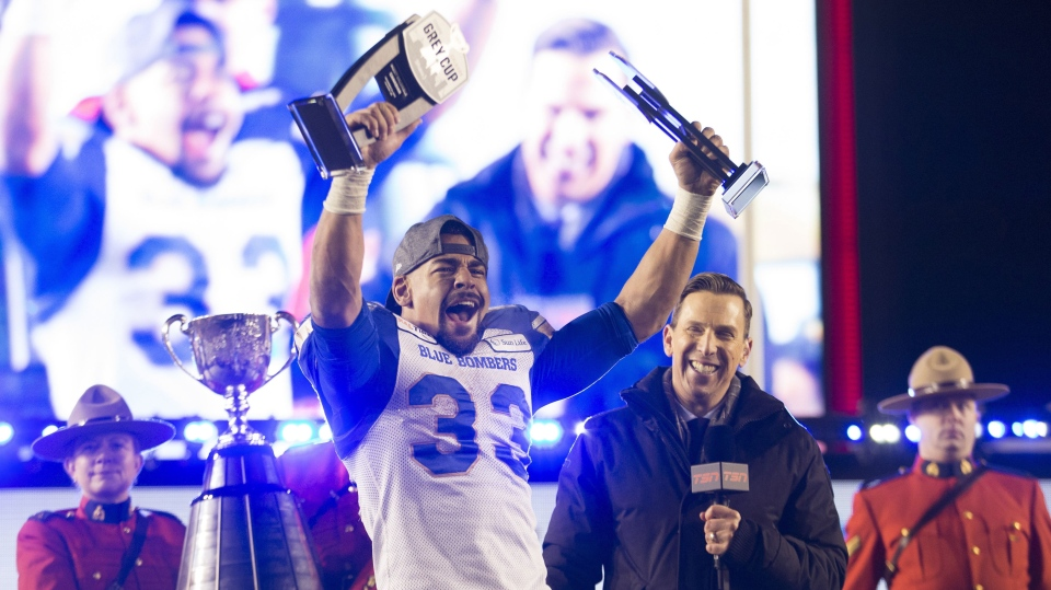 Winnipeg Blue Bombers' Andrew Harris hoists the Most Outstanding Canadian and Most Valuable Player awards after winning the 107th Grey Cup against the Hamilton Tiger Cats in Calgary, Alta., Sunday, November 24, 2019. (Source: Todd Korol/The Canadian Press)