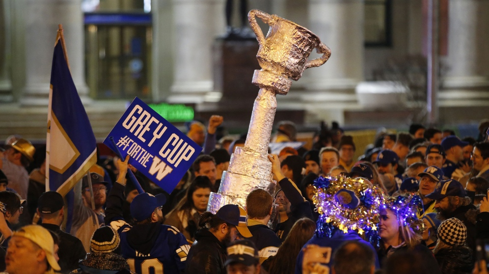 Winnipeg Blue Bomber fans celebrate winning the 107th Grey Cup over the Hamilton Tiger Cats at the intersection of Portage and Main in Winnipeg Sunday, November 24, 2019. It's been 29 years since the Bombers last won the Grey Cup. (Source: John Woods/The Canadian Press)