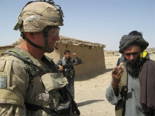 Canadian Capt. St�phane Girard talks to a villager, north of Kandahar, Afghanistan, Sunday, Aug.5, 2007. (CP PHOTO/Martin Ouellet)