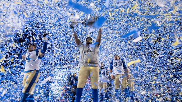 The Winnipeg Blue Bombers celebrate winning the Grey Cup CFL football championship against the Hamilton Tiger Cats, Sunday, Nov. 24, 2019, in Calgary, Alberta. (Nathan Denette/The Canadian Press via AP)