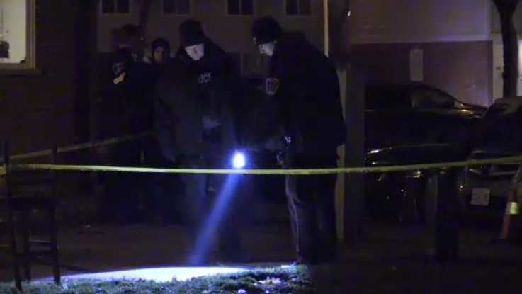 Police investigate after gunfire at a townhouse complex in London, Ont. on Sunday, Nov. 24, 2019.