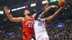 Philadelphia 76ers' Tobias Harris, right, shoots as Toronto Raptors' Marc Gasol defends during first half NBA basketball action in Toronto on Monday, November 25, 2019. THE CANADIAN PRESS/Chris Young