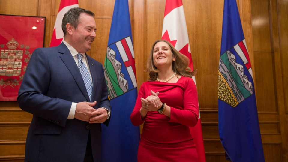 Deputy Prime Minister Chrystia Freeland and Alberta Premier Jason Kenney take part in a photo opportunity ahead of their meeting in Edmonton on Monday, November 25, 2019. THE CANADIAN PRESS/Amber Bracken