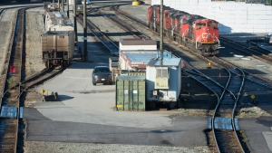 A quiet McLean Rail Yard is pictured in North Vancouver, Wednesday, November 20, 2019 as CN rail workers strike outside the gates. (THE CANADIAN PRESS / Jonathan Hayward)