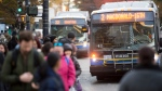 A bus is pictured in downtown Vancouver, Friday, November, 1, 2019. (THE CANADIAN PRESS/Jonathan Hayward)