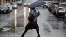 A woman walks in the rain in San Francisco in this file photo. (Jeff Chiu/AP)
