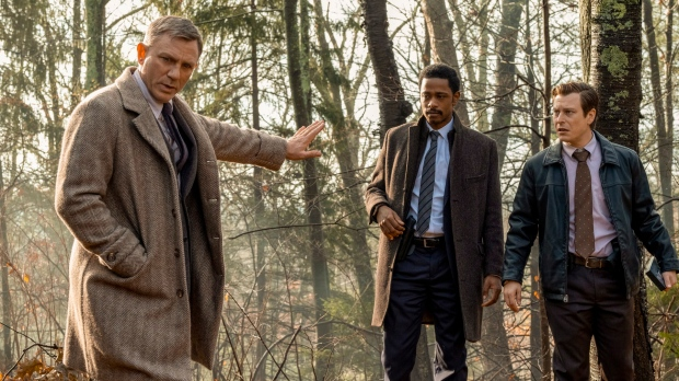 "This image released by Lionsgate shows Daniel Craig, from left, Lakeith Stanfield and Noah Segan in a scene from ""Knives Out."" (Claire Folger/Lionsgate via AP)"
