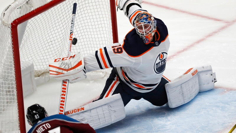 Colorado Avalanche left wing Matt Nieto, front, fires the puck past Edmonton Oilers goaltender Mikko Koskinen for a goal during the third period of an NHL hockey game Wednesday, Nov. 27, 2019, in Denver. The Avalanche won 4-1. (AP Photo/David Zalubowski)