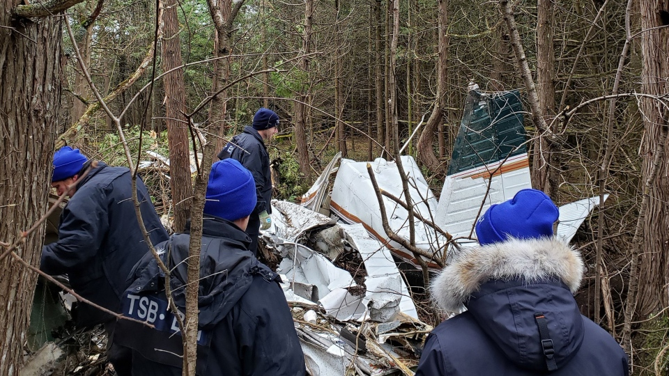 The Transportation Safety Board of Canada posted a photo to Twitter of the fatal plane crash site in Kingston, Ont. on Thursday, Nov. 28, 2019. The crash happened Wednesday at 5 p.m. in a wooded area. Seven people have been killed, including 3 children. (@TSBCanada/Twitter)