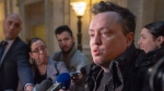 Comedian Mike Ward speaks to the media at the Quebec Appeal Court Wednesday, January 16, 2019 in Montreal. The Court is hearing arguments about whether Ward, who joked of drowning a disabled boy, Jeremy Gabriel, should have to pay damages to him and his family. THE CANADIAN PRESS/Ryan Remiorz