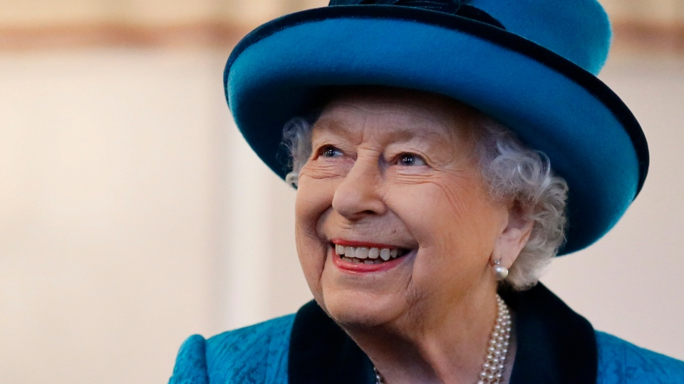 Britain's Queen Elizabeth II visits the new headquarters of the Royal Philatelic society in London Tuesday Nov. 26, 2019. (Tolga Akmen / Pool via AP)