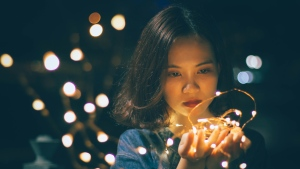A woman with holiday decorations is seen in this file image. (Pexels)