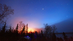 Early sunrise from Lac Seul. Photo by Bobby Binguis.