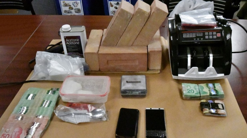 Cocaine and drug paraphernalia seized by police in London, Ont. on Thursday, Nov. 28, 2019 are seen in this image provided by the London Police Service.