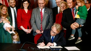 In this April 11, 2019 file photo, Gov. Mike DeWine signs a bill imposing one of the nation's toughest abortion restrictions, in Columbus, OH. (Fred Squillante/The Columbus Dispatch via AP, File)