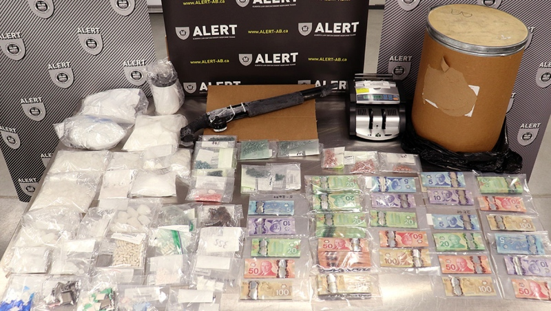 ALERT Calgary seized over $300,000 worth of drugs, a significant amount of cash and a sawed-off shotgun following the search of a home in Riverbend.