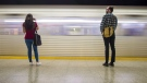 Commuters wait to take the subway at Ossington Station in Toronto on Friday, June 22, 2018. THE CANADIAN PRESS/ Tijana Martin