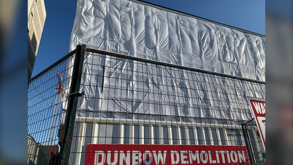 Asbestos removal begins at condemned Kensington Manor on 10th Street N.W.