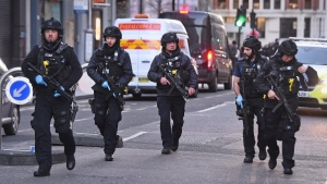 Police on Cannon Street in London near the scene of an incident on London Bridge in central London following a police incident, Friday, Nov. 29, 2019. (Kirsty O'Connor/PA via AP)